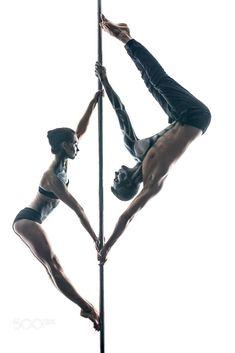 Couple of pole dancers with body-art on pylon by Andrey Bezuglov on 500px #poledancingmoves #poledance