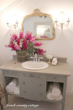 Bathroom vanities made out of dressers and desks.