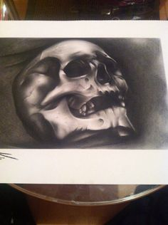 Skull drawing... Charcoal and white chalk.