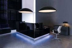 Color is everything when it comes to design. Set the mood with this sleek black design for your reception desk. Need more ideas for your reception area? Visit us online. We have reception desks to suit every modern office decor. Contemporary Office Chairs, Modern Office Design, Office Furniture Design, Unique Furniture, Furniture Ideas, Curved Reception Desk, Reception Desk Design, Reception Desks, Minimalistic Style