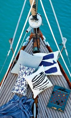 the bow of a boat with pillows = dream  My most favorite place to relax. The bow of a moving boat