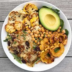 Fall bowl of Veggie Goodness   Save Print A simple bowl of veggie goodness. Autumn Quinoa Salad, Roasted Cauliflower, Roasted Delicata Squash, Roasted Chickpeas and avocado, all on a bed of le…