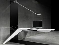 "Bulgarian studio Bozhinovskidesign have created a cantilevered desk suspended from the wall by steel cables. Called E.L.A, the desk is made of fibreglass. Cables for a computer can be passed through apertures in the end and sides, and a flap in the underside provides storage. ""The idea was that the desk flies on the air,"""