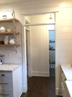 Love the shiplap and extra trim at bottom of door frames.