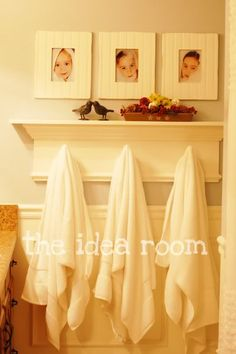 Great idea for trying to make every room of the house lovely -- which Includes The Bathroom! I like the sweet white frames with pictures of the kids' faces. (And a towel rack to hold each person's towel)
