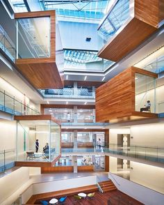 Perkins + Will incorporated transparency in their design of the Allen Institute, a medical research facility in Seattle. The open central atrium replicates the effect of a bee hive where staff and researchers are fully visible — this makes the space flexible and collaborative, enables more chance encounters between staff, and helps build community. #architecture #design #interiors #interiordesign @perkinswill... - Interior Design Ideas, Interior Decor and Designs, Home Design Inspiration…