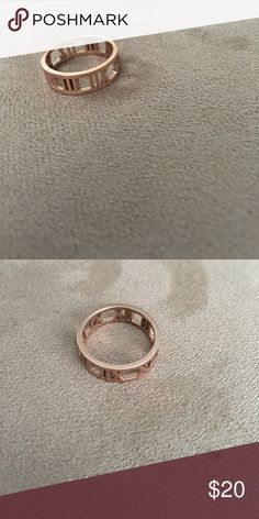 Rose Gold Roman Numeral Ring Rose Gold Ring. Very similar style to Atlas Ring by Tiffany's. Considered replica. Stainless steel. Will not turn finger green. Brand new. Jewelry Rings