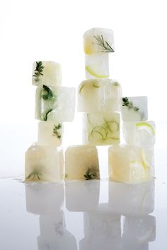 Citrus-Lemongrass Ice Cubes ~ Although lemongrass can be found year-round in ethnic grocery stores, the warm-weather herb is at its peak in the summer. Here it's infused into lightly sweetened water and frozen into cubes to add herbal interest to all sorts of summer beverages, from iced tea to cocktails. For extra visual flair, drop a fresh herb sprig, an edible flower, a slice of cucumber, a sliver of citrus, or a cherry tomato half into each mold, cover with lemongrass mixture, and freeze…