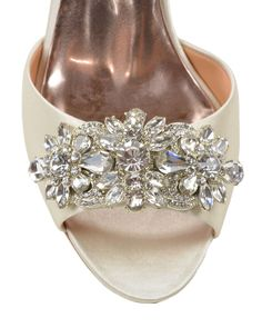 Giana Embellished Toe Evening Shoe - Style # : GIANA - IVORY - $225.00 - Giana by Badgley Mischka. The Giana evening shoe is a stunning peep-toe style. The elegant heels shine with a show-stopping, sparkly rhinestone decoration at the toe. The d'orsay heel style is an elegant and glamorous choice for any special event. - Heel height: 3 3/4 inches. - Sale price is only applicable to online purchases and not valid in Badgley Mischka stores. Items purchased on BadgleyMischka.com cannot be…