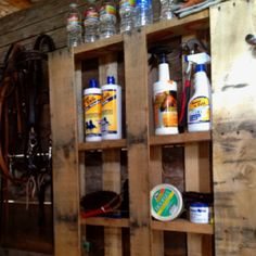 Re-purposed pallet shelf for horse supplies. Brilliant! I love a good barn hack.  Could even hang it on the wall to keep it up higher.