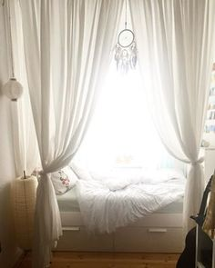 Make your own private world with these bed curtains. | 21 Cosy Bedrooms That Will Make You Want To Sleep In