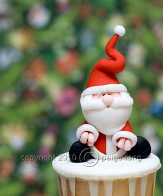 Santa Claus Cupcake by Paige Fong, via Flickr