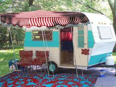 my vintage camper! It's my red and aqua dream home! (the inside is done in a denim and red cowgirl motif!)