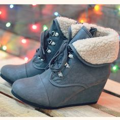 http://www.amazinglace.com/collections/shoes/products/when-skies-are-gray-wedge-fur-booties