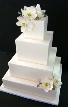Classic white four tier square #wedding #cake with magnolia flowers