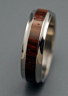 Sometimes all that is needed is a shared glance or nod. Rich Cocobolo wood says it all in this stunning titanium band with flared edges. Naturally oil-rich and extremely durable, Cocobolo needs little