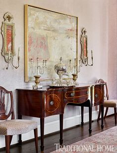 Artwork and sconces in the dining room continue the subtle pink palette. - Photo: Emily Jenkins Followill / Design: Carolyn Kendall with Betsy Trabue