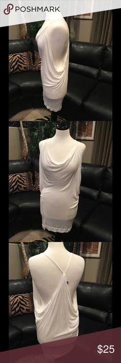 Tart Collections White Cotton Swimsuit Cover Up Tart Collections White cotton swim coverup or Tunic if you wanted. Cute draped t-back style. I never wore since I didn't think I looked good in this body hugging style. 😬 Size Medium. Feels like your favorite soft t-shirt. 🙂 Tart Collection Swim Coverups