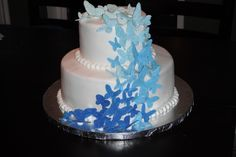 This was for a bridal shower- the bride to be LOVES butterflies and her wedding colors are blue and silver. Covered in buttercream with gumpaste butteflies made with a patchwork cutter. This is definitely one of my favorite cakes that I've done!!