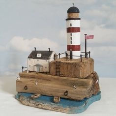 Up to the lighthouse.  #driftwood #shabbydaisies #littlehouse #nautical #flag…
