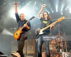 Alex Lifeson, Geddy Lee and Neil Peart of Rush perform on the final night of their north American tour at Cruzan Amphitheatre on October 2010 in West Palm Beach, Florida. Get premium, high resolution news photos at Getty Images Great Bands, Cool Bands, Rush Music, Rush Concert, Rush 2, Rush Band, Pop Rock Music, Geddy Lee, Alex Lifeson