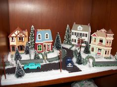the average designer displaying nostalgic houses and shops by hallmark christmas village display christmas - Hallmark Christmas Village