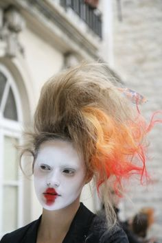 Fiery back combed hair and unconventional lips at Vivienne Westwood Womenswear SS10. Photography by Angela di Paola. More images here: http://www.dazeddigital.com/vivienne-westwood-takeover