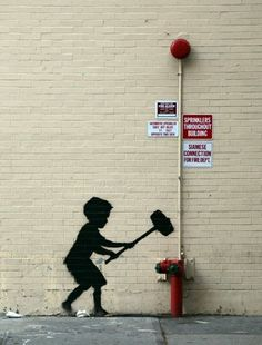 Famous street artist Banksy having some fun with a fire department connection.