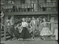 """Bob Fosse, Debbie Reynolds, Bobbby Van and Barbara Ruick Dance and Sing in movie, """"The Affairs of Dobie Gillis (1953).  Fosse is in the sweater with the light socks.  He might not have choreographed this number, but the man can dance!"""