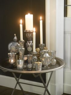 pretty candle light vignette on a silver tray