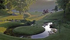 Innisfree Garden in Millbrook, NY -   a site-specific distillation of Modernist ideas with traditional Chinese and Japanese garden design principles. The result is a distinctly American stroll garden on 185-acres surrounding a large, glacial lake—a sublime landscape of rock, water, wood, and sky.