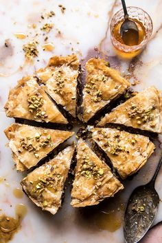 A lightened up and easier-to-make version of the traditional Baklava. Get the recipe: Easy Pistachio Chocolate Baklava Greek Desserts, Köstliche Desserts, Greek Recipes, Delicious Desserts, Dessert Recipes, Yummy Food, Plated Desserts, Health Desserts, Cake Recipes