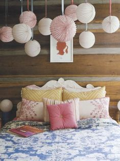 I love the lanterns above the bed.