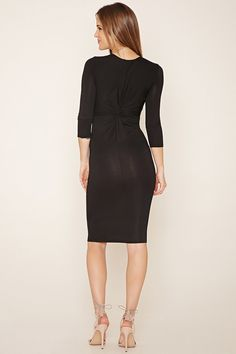 This long-sleeved knit bodycon dress features a twisted back and a round neckline.