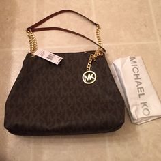 Beautiful Michael kors jet set chain shoulder tote Michael kors jet chain shoulder tote in dark brown. Comes with dust bag. Sorry I do not trade. Michael Kors Bags