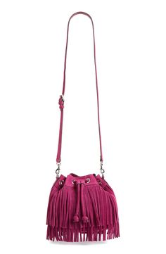 This Rebecca Minkoff drawstring bucket bag gives a graceful boho-chic look with its curtains of swingy fringe.