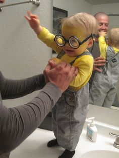 My perfect little minion.  Yellow Facepaint, yellow onesie, overalls, black socks & gloves, goofy glasses from the dollar store and a glasses strap. [and some hair gel for that part down the middle]