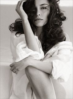 I love the pose, the big white shirt, and the big curls framing her face.