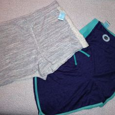 "Bundle of 2 Shorts Plus Size These shorts are so comfy. I wear this same size and brand a lot. They are in NWT condition and never worn. Great for jogging or walking or just running around. The purple/green measure 18 1/2"" side to side at top of waist (waist does stretch) and the beige is about 20"" but has a draw string to let in or out some. I love the lace down the sides of the beige ones and the color and dry fit of the purple ones. Just Be Shorts"