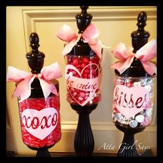 Fun candy-filled apothecary jars decorated with vinyl decals for Valentine's Day. By AttaGirlSays.com