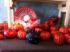 This fun Halloween display at Isabel's in South Miami gives a new fun use for our Coral Nautilus Platter!