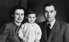 Studio portrait of an Austrian-Jewish couple and their young daughter.  Pictured are Ernst, Paul and Lisl Porges.