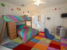 A colorful kid's room with enough space for three. A desk in the corner has the television and a GameCube. A border of multi-colored circles runs along the top of the room. Bunk Bed Rooms, Cool Bunk Beds, Kids Bunk Beds, Cool Kids Bedrooms, Kids Bedroom Designs, Girls Bedroom, Bedroom Ideas, Boy Room, Kids Room