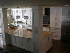 i would love to have a kitchen like this!  well, maybe not white.  Pillar open kitchen concept
