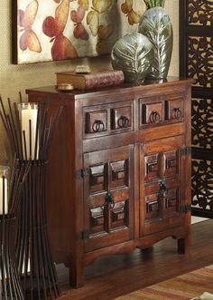With lion's head hardware, Pier 1 Ashok Cabinet stands guard in any room