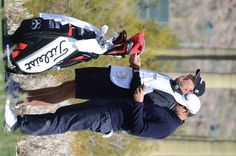 Adam Scott discussing the hole with his caddie at the 2013 Accenture Match Play event in Marana, AZ