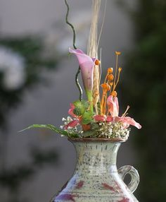 Beautiful flower arrangements in functional pottery. It's a shame it's only in Irvine, would love those here as well.