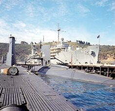 Aft view of sail, 1969.  USS Cusk is tied up  to the USS Scamp and the tender USS Nereus in San Diego