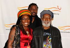 """Burning Spear Sonia Rodney Photos - Sonia Rodney (L) and Burning Spear (R) attend the Michael J. Fox Foundation's 2010 Benefit """"A Funny Thing Happened on the Way to Cure Parkinson's"""" at The Waldorf=Astoria on November 13, 2010 in New York City. - 2010 A Funny Thing Happened On The Way To Cure Parkinson's - Arrivals"""