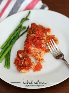Easy foil pack baked salmon topped with tomatoes, full of flavor and no mess.